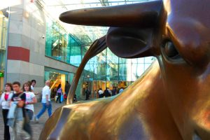 bull-in-bullring-and-people-shopping