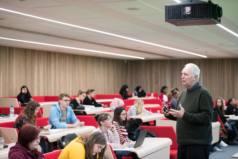 Students sitting in lecture and lecturer teaching