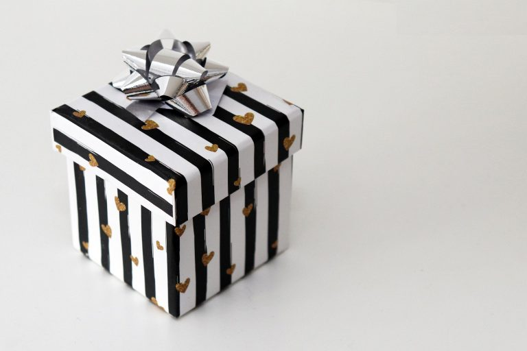 Black and white gift box with gold hearts and silver ribbon