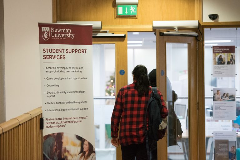 Students walking into the Student Support Services office
