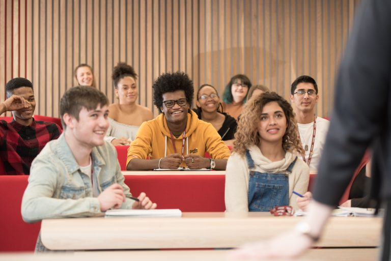 students in a lecture theatre looking towards lecturer