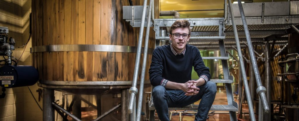 student completing work placement in local brewery